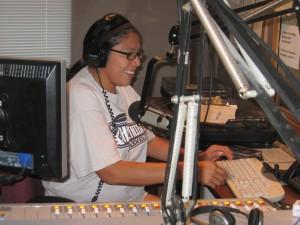 Rhonda Levaldo reads the news at KKFI studios